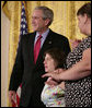 "President George W. Bush embraces stem cell patient Kaitlyne McNamara following his address on the reasons he vetoed S.5, the ""Stem Cell Research Enhancement Act of 2007,"" in the East Room of the White House Wednesday, June 20, 2007. McNamara was born with spina bifida, a disease that damaged her bladder, her doctors isolated healthy stem cells in a piece of her own bladder and used them to grow her a new bladder. White House photo by Eric Draper"