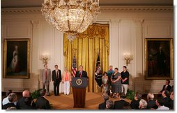 "President George W. Bush, joined by families who were aided by the use of adult stem cells in their health treatments, addresses his remarks concerning his veto of S.5, the ""Stem Cell Research Enhancement Act of 2007,"" in the East Room of the White House Wednesday, June 20, 2007.  White House photo by Joyce N. Boghosian"
