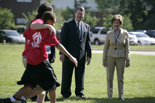 Mrs. Laura Bush and Mike Gottfried, CEO of Team Focus, watch Team Focus participants run a relay race Thursday, June 21, 2007, in Mobile, Ala., during a visit to Team Focus' National Leadership Camp, as part of Helping America's Youth initiative. Team Focus is a faith-based, nonprofit organization devoted to improving the lives of young men, ages 10-18, without fathers in their lives. White House photo by Shealah Craighead