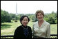 Mrs. Laura Bush and Madame Chi, wife of Vietnam President Nguyen Minh Triet, pose for a photo Friday, June 22, 2007 on the Truman Balcony, during Madame Chi's visit to the White House. White House photo by Chris Greenberg