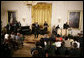 Singer KEM and his band perform a song for President George W. Bush and guests Friday, June 22, 2007 in the East Room of the White House, in celebration of Black Music Month. White House photo by Eric Draper