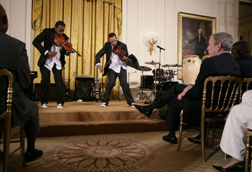 President George W. Bush and guests watch violinists Tourie and Damien Escobar of Nuttin' But Stringz, as they perform Friday, June 22, 2007 in the East Room of the White House, in celebration of Black Music Month. White House photo by Eric Draper