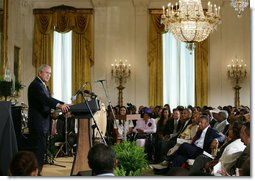 President George W. Bush welcomes guests to the East Room of the White House Friday, June 22, 2007, to join in a celebration of Black Music Month, focusing on the music of hip hop and R &B artists.  White House photo by Eric Draper
