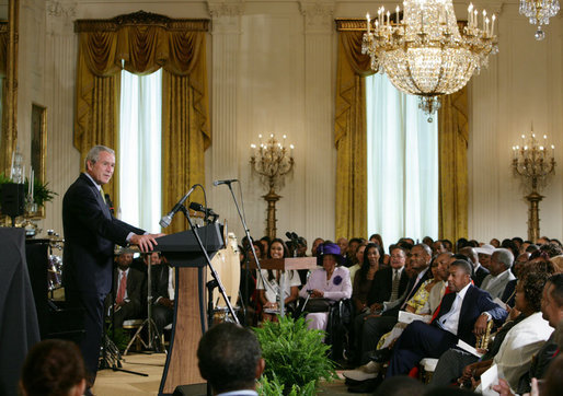 President George W. Bush welcomes guests to the East Room of the White House Friday, June 22, 2007, to join in a celebration of Black Music Month, focusing on the music of hip hop and R &B artists. White House photo by Chris Greenberg