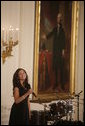 Singer Karina Pasian stands before a portrait of George Washington as she performs for President George W. Bush and guests Friday, June 22, 2007 in the East Room of the White House, in celebration of Black Music Month. White House photo by Debra Gulbas