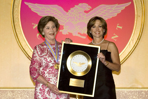 Dorothy Hamill, 1976 US Gold Medal Olympic Champion, presents Mrs.Laura Bush the Academy of Achievement Golden Plate Award Friday, June 22, 2007, during a ceremony in Washington, D.C. Mrs. Bush was presented the award for her achievements in Public Service, Friday, June 22, 2007. President George H.W. Bush received the Golden Plate Award in 1995. White House photo by Shealah Craighead