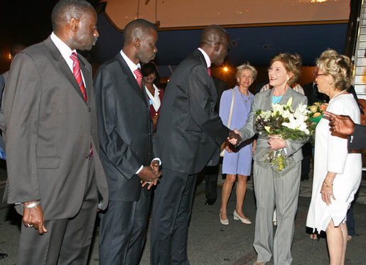 Mrs. Laura Bush, arriving Monday evening, June 25, 2007 in Dakar, Senegal, is greeted by the First Lady of Senegal, Mrs. Viviane Wade, right, making introductions to Senegal Education Minister Dr. Moustapha Sourang , Dr. Issa Mbaye Samb, Minister of Health and Airport Director Mbaye Ndiaje, left. Mrs. Bush is traveling to Senegal, Mozambique, Mali and and Zambia to highlight efforts to combat Malaria and HIV/AIDS. White House photo by Shealah Craighead