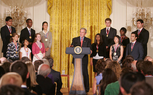 President George W. Bush congratulates the 2007 Presidential Scholars Monday, June 25, 2007 in the East Room of the White House, and highlights the need to reauthorize the No Child Left Behind Act this year. White House photo by Joyce N. Boghosian