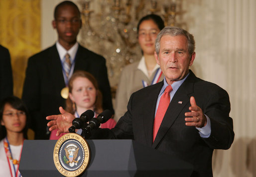 President George W. Bush gestures as he congratulates the 2007 Presidential Scholars Monday, June 25, 2007 in the East Room of the White House, and highlights the need to reauthorize the No Child Left Behind Act this year. White House photo by Joyce N. Boghosian