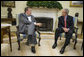 "President George W. Bush meets with President Toomas Ilves of Estonia, during their meeting Monday, June 25, 2007, in the Oval Office. Calling him a ""President of a country which has emerged from some really dark days,"" President Bush welcomed the leader to the White House saying, ""President Ilves is a very strong advocate for democracy and the marketplace."" White House photo by Eric Draper"
