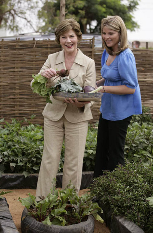 Mrs. Laura Bush and Ms. Jenna Bush pick vegetables during their visit to the Fann Hospital garden with Senegalese First Lady Viviane Wade and her daughter Tuesday, June 26, 2007, in Dakar, Senegal. Supported by USAID, the Fann Hospital gardens provide fresh vegetables to address the nutritional needs of patients with HIV/AIDS, an overlooked, but essential part of their care. White House photo by Shealah Craighead