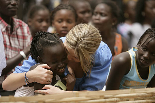 Ms. Jenna Bush hugs a little girl who danced during a performance Tuesday, June 26, 2007, by musician Youssou N'Dour for the children at Grand Medine Primary School in Dakar, Senegal. White House photo by Shealah Craighead