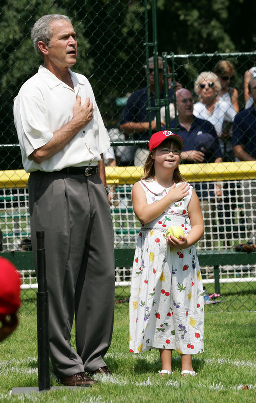 President George W. Bush is joined for the singing of the national anthem by Meredith Cripe, a member of the Chantilly, Virginia Little League Challenger League, at the top of the first White House Tee Ball Game of the 2007 season. The game pitted the Bobcats from Cumberland, Maryland, against the Red Wings of Luray, Virginia. White House photo by Eric Draper