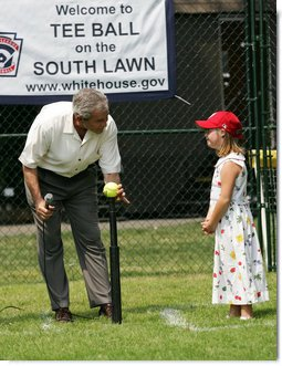 Under the watchful eye of Meredith Cripe, a member of the Chantilly, Virginia Little League Challenger League, President George W. Bush places a ball on the tee to start the game and the 2007 White House Tee Ball Season on the South Lawn. The game pitted the Bobcats from Cumberland, Maryland, against the Red Wings of Luray, Virginia. White House photo by Eric Draper