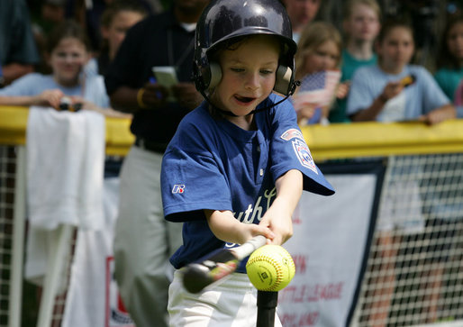 The tongue is out as the swing is swung during an at bats for a Bobcat from Cumberland, Maryland Wednesday, June 27, 2007, against the Luray, Virginia Red Wings on the South Lawn. The game marked the opening of the 2007 White House Tee Ball season. White House photo by Eric Draper