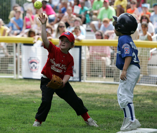 It's safe at first for a Cumberland Bobcat as the Red Wings' first baseman returns the ball to the catcher Wednesday, June 27, 2007, during the first game of the 2007 White House Tee Ball season on the South Lawn. The game pitted the Luray, Virginia team against the Cumberland, Maryland kids, and marked the seventh year of the President's White House Tee Ball Initiative. White House photo by Eric Draper