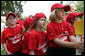 Members of the Luray, Virginia Red Wings watch from the bench Wednesday, June 27, 2007, during the first White House Tee Ball Game of the 2007 season as they go against the Bobcats from Cumberland, Maryland, on the South Lawn of the White House. White House photo by Chris Greenberg