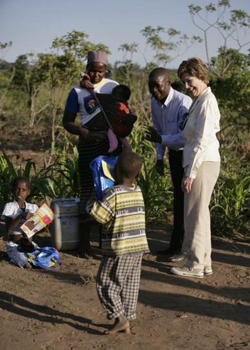 Mrs. Laura Bush visits a malaria spraying site Wednesday, June 27, 2007, in Mozal, Mozambique. Each year more than one million people die of malaria. Of these deaths, 85 percent occur in sub-Saharan Africa. For children in Africa, malaria is the leading cause of death. White House photo by Shealah Craighead