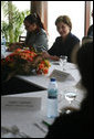 Mrs. Laura Bush meets with local women community leaders for a roundtable discussion Wednesday, June 27, 2007, in Maputo, Mozambique. During their talk about women's empowerment, domestic violence, and HIV/AIDS, Mrs. Bush underlined the administration's commitment to women's rights in Africa. White House photo by Shealah Craighead