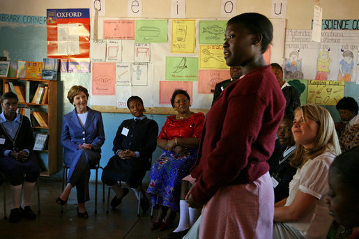 "Mrs. Laura Bush and Ms. Jenna Bush meet with educators and student at Regiment Basic School Thursday, June 28, 2007, in Lusaka, Zambia. Of the 1,200 students at the school, 300 are orphans. After meeting with the students and watching skits and song performances, Mrs. Bush addressed the press saying, ""I just met with a group of girls who are receiving scholarships, some of them are orphan girls, orphans because their parents died of AIDS, and they're receiving scholarships from PEPFAR, the President's Emergency Plan for Aids Relief."" White House photo by Shealah Craighead"