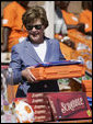 Mrs. Laura Bush assembles a home care kit at the Mututa Memorial Center Thursday, June 28, 2007, in Lusaka, Zambia. The center provides many humanitarian services including home-based care for people living with HIV/AIDS, care for orphans and promotes abstinence and faith for youth. It serves more than 150 individuals with a core of 36 trained caregivers. White House photo by Shealah Craighead