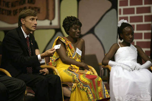 U.S. Global AIDS Coordinator Ambassador Mark Dybul holds up a SMART card during a roundtable discussion with Mrs. Laura Bush, Mrs. Maureen Mwanawasa, doctors, patients and officials about HIV/AIDS at Chreso Ministries, which provides counseling, testing and support for people living with HIV/AIDS, Thursday, June 28, 2007, in Lusaka, Zambia. The card contains the medical history of its holder and facilitates accurate and efficient health care for patients. White House photo by Shealah Craighead