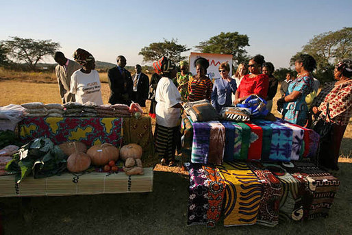 At the Flame Community Center in Lusaka, Zambia, Mrs. Laura Bush, Ms. Jenna Bush and Zambian First Lady Mrs. Maureen Manawasa visit a marketplace demonstrating small enterprises begun with the help of WORTH, a program that trains women in literacy, group savings, peer lending and small business development. White House photo by Shealah Craighead