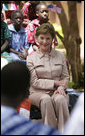 Mrs. Laura Bush visits with students and teachers at the Nelson Mandela Primary School Complex Friday, June 29, 2007, in Bamako, Mali. The United States is partnering with African nations in the Africa Education Initiative, a $600 million dollar investment that will provide 550,000 scholarships to African children and train thousands of teachers by 2010. White House photo by Shealah Craighead