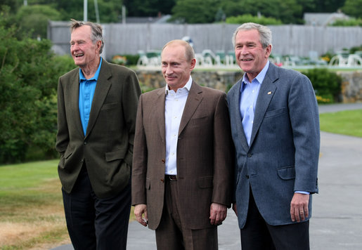 President George W. Bush stands with Russian President Vladimir Putin and Former President George H.W. Bush after Putin's arrival at Walker's Point in Kennebunkport, Maine, Sunday, July 1, 2007. White House photo by Eric Draper