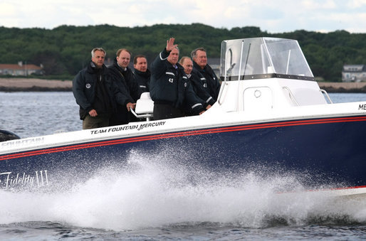 President George W. Bush and Russian President Vladimir Putin tour the coastline with Former President George H. W. Bush aboard Fidelity III in Kennebunkport, Maine, Sunday, July 1, 2007. White House photo by Eric Draper