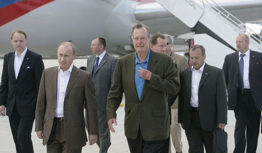 Former President George H.W. Bush leads the way for Russian President Vladimir Putin Sunday, July 1, 2007, after his arrival in the United States at Pease Air National Guard Base in Portsmouth, N.H. White House photo by Joyce N. Boghosian