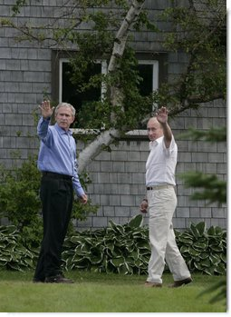 President George W. Bush and Russia's President Vladimir Putin wave as they leave a press availability Monday, July 2, 2007, at Walker's Point in Kennebunkport, Me.  White House photo by Joyce N. Boghosian