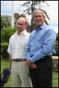 "President George W. Bush stands with President Vladimir Putin, prior to the Russian leader's departure Monday, July 2, 2007, from Kennebunkport, Me. Said President Bush, ""When Russia and the United States speak along the same lines, it tends to have an effect and therefore I appreciate the Russians' attitude in the United Nations. We're close on recognizing that we got to work together to send a common message."" White House photo by Eric Draper"