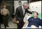 As a Military Aide to the President reads the citation, President George W. Bush honors Sgt. 1st Class Andy Allen with a Purple Heart Tuesday, July 3, 2007, during a visit to Walter Reed Army Medical Center in Washington, D.C., where the Elk City, O.K., soldier is recovering from wounds received in Operation Iraqi Freedom. White House photo by Eric Draper