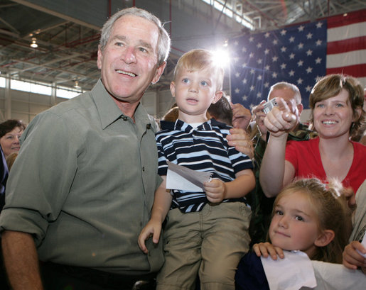 President George W. Bush poses for photos during his visit Wednesday, July 4, 2007, with members of the West Virginia Air National Guard 167th Airlift Wing and their family members in Martinsburg, W. Va. White House photo by Chris Greenberg