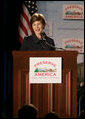 Mrs. Laura Bush addresses her remarks at the Preserve America grants presentation Thursday, July 12, 2007, at the Cannon House Office Building at the U.S. Capitol in Washington, D.C., honoring communities that use their historic assets to educate visitors and local residents about their town's important links to our nation's past. Mrs. Bush also took the occassion to honor the memory of former First Lady Lady Bird Johnson, remembered for her love of America's environment and history. White House photo by Shealah Craighead