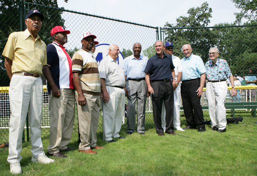 President George W. Bush, joined Baseball Hall of Fame player and honorary tee ball commissioner Frank Robinson, center, along with Hall of Fame manager Tommy Lasorda and fellow legendary players, retire the number of baseball great Jackie Robinson at the White House Tee Ball Game Sunday, July 15, 2007, on the South Lawn of the White House. All players wore the number 42 to celebrate the legacy of Jackie Robinson. More about Tee Ball on the South Lawn. White House photo by Chris Greenberg