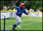 A player from the Inner City Little League of Brooklyn, N.Y. runs for first base after his hit against the Wrigley Little League Dodgers of Los Angeles Sunday, July 15, 2007 at the White House Tee Ball Game, in honor of legendary baseball player Jackie Robinson. More about Tee Ball on the South Lawn. White House photo by Chris Greenberg