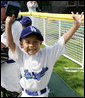 An excited member of the Wrigley Little League Dodgers of Los Angeles shows off his Presidential autographed baseball following their game against the Inner City Little League of Brooklyn, N.Y., Sunday, July 15, 2007, at the White House Tee Ball Game celebrating the legacy of Jackie Robinson on the South Lawn of the White House. Brooklyn and Los Angeles represent the two home cities of Robinson's team. More about Tee Ball on the South Lawn. White House photo by Joyce N. Boghosian