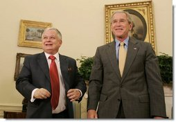President George W. Bush and Polish President Lech Kaczynski conclude their meeting in the Oval Office Monday, July 16, 2007, where the two leaders met to discuss economic and mutual security issues. White House photo by Joyce N. Boghosian