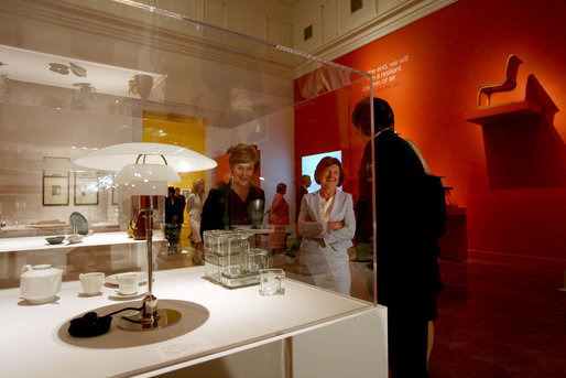 "Visiting the Corcoran Gallery of Art, Mrs. Laura Bush and Mrs. Maria Kaczynska, First Lady of Poland, look at Poul Henningsen's table lamp, ""PH"", during a tour of the exhibit Modernism: Designing a New World, 1914-1939, Monday, July 16, 2007, in Washington, D.C. They are led by Director and President Paul Greenhalgh and Administrative Design Chair Catherine Armour. White House photo by Shealah Craighead"