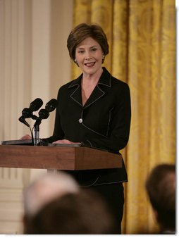 Mrs. Laura Bush welcomes award winners and guests to the East Room of the White House Wednesday, July 18, 2007, to honor the recipients of the 2007 Cooper-Hewitt National Design Awards. White House photo by Shealah Craighead