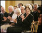 Mrs. Laura Bush, seated next to design award recipient Robert Venturi, applauds the winners of the 2007 Cooper-Hewitt National Design Awards Wednesday, July 18, 2007, in the East Room of the White House. White House photo by Shealah Craighead