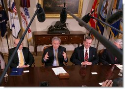 President George W. Bush gestures as he speaks to members of the media Wednesday, July 18, 2007 in the Roosevelt Room at the White House, following a meeting with the Import Safety working group, where President Bush announced an updated review of the food safety regulations and inspection procedures will be conducted to ensure the nation's food supply remains the safest in the world. White House photo by Eric Draper