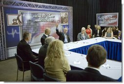 "President George W. Bush participates in a roundtable discussion about health care initiatives after touring the company Man & Machine, Inc. Wednesday, July 18, 2007, in Landover, Md. ""Some in Congress believe the best solution to solving the frustrations of uninsured and high costs for small businesses is to expand the role of government. I have a different point of view,"" said the President. ""I believe the best way to deal with the frustrations of the high cost of health care and uninsured is to change the tax code, is to make health care in the private sector more affordable and more available.""  White House photo by Chris Greenberg"