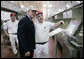 President George W. Bush is shown a section of the bun production line by an employee Thursday, July 19, 2007, at the Nashville Bun Company in Nashville, Tenn. White House photo by Chris Greenberg