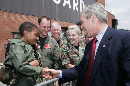President George W. Bush introduces himself to a young child Thursday, July 19, 2007, at the Tennessee Air National Guard base in Nashville, Tenn., prior to his departure back to Washington, D.C., following a visit to the Nashville Bun Company and a speech at the Gaylord Opryland Resort and Convention Center. White House photo by Chris Greenberg