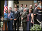 "President George W. Bush, joined by veterans and military families, discusses the Global War on Terror in the Rose Garden Friday, July 20, 2007. During his statement, the President quoted Air Force Reservist Eric Egland saying, ""We live in the world's oldest democracy and have been blessed with the strength to protect our freedoms and to help others who seek the same."" White House photo by David Jolkovski"