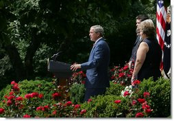 "Standing with veterans and military family members, President George W. Bush delivers remarks on the Global War on Terror Friday, July 20, 2007, in the Rose Garden. ""When Congress returns after Labor Day, there will be less than one month before the fiscal year ends and current funds for Defense Department operations run out,"" said the President. ""Congress still has an opportunity to do right by our men and women in uniform -- and our national security. So today I call on Congress to take action and get this vital piece of legislation to me to sign -- on budget and on time."" White House photo by Joyce N. Boghosian"