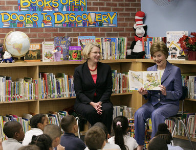 Mrs. Laura Bush, joined by U.S. Secretary of Education Margaret Spellings, reads to children at the Driggs School in Waterbury, Conn., Tuesday, July 24, 2007. Mrs. Bush also announced the 2007 Improving Literacy through School Libraries grants being awarded by the U.S. Department of Education. White House photo by Shealah Craighead